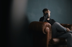 depressed man sitting in a chair