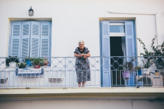 old greek lady on balcony